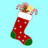 Christmas stocking with colored candies and gingerbread man. Decorative red sock for christmas holiday. Vector illustration. royalty free illustration