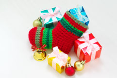 Christmas stocking and colorful presents. Stock Photography