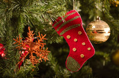 Christmas stocking decoration on Christmas tree Stock Photo