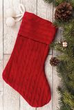 Christmas stocking and decoration on white plank in background. stock photos