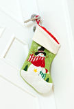 Christmas stocking on door Royalty Free Stock Photo