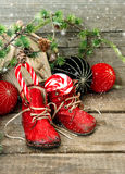 Christmas stocking. festive nostalgic decoration. Christmas stocking. nostalgic decoration with antique toys and vintage baby shoes over wooden background. retro stock photo