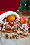 Christmas stocking filled with fruit and nuts Royalty Free Stock Photography