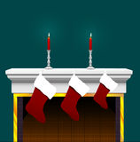 Christmas Stocking On Fireplace. Ready to stuff with your goodies: 3 Christmas Stockings, on a Fireplace Mantle with candles and candlesticks Stock Image