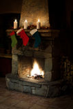 Christmas stocking on fireplace. Chimney place. Christmas stocking on fireplace background. Chimney, candles and woodpile. Chimney place stock photography