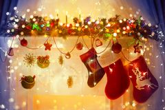 Christmas Stocking on Fireplace, Hanging Xmas Family Socks. On decorated Fire Place Royalty Free Stock Photos