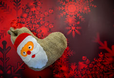 Christmas stocking. Funny Christmas stocking on red background Royalty Free Stock Photography