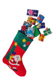 Christmas stocking and gifts isolated over white. Royalty Free Stock Photos