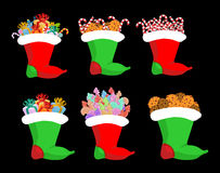 Christmas stocking with gifts set. Candy cane and cookie. lollip Stock Image