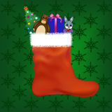 Christmas stocking with gifts and toys Stock Photos