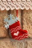 Christmas stocking hanging in the fireplace Stock Photo
