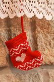 Christmas stocking hanging in the fireplace Stock Image