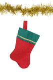 Christmas stocking hanging on gold garland Royalty Free Stock Photo