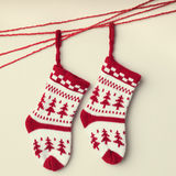 A Christmas stocking hanging on a red string Royalty Free Stock Images