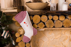 Christmas Stocking Hanging from Rustic Mantle Stock Images
