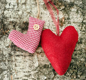 Christmas stocking and heart on wooden background Stock Photo