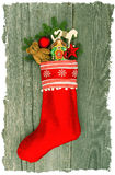 Christmas stocking with nostalgic antique toy deco Royalty Free Stock Photo