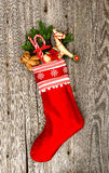 Christmas stocking with nostalgic vintage toy decoration Stock Photography