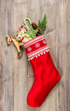 Christmas stocking with nostalgic vintage toys decoration Royalty Free Stock Photos