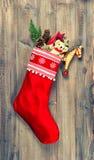 Christmas stocking with nostalgic vintage toys decoration Royalty Free Stock Photos