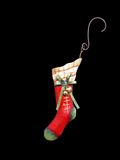 Christmas Stocking Ornament. Decorative Christmas stocking ornament isolated on black background Stock Image