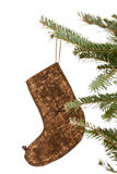 Christmas Stocking Ornament Hanging from a Tree. Christmas stocking ornament dangling from a Christmas tree branch isolated on white Royalty Free Stock Photo