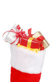 Christmas stocking packed with gifts Stock Photography