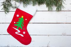 Christmas stocking and pine branches.  Stock Photo
