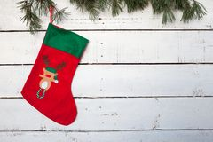 Christmas stocking and pine branches Stock Photo
