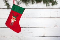 Christmas stocking and pine branches Stock Image