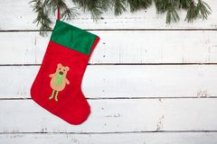 Christmas stocking and pine branches Royalty Free Stock Photography