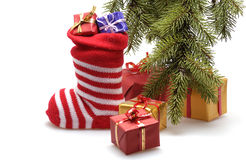 Christmas stocking and presents Stock Images