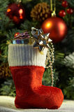 Christmas stocking with presents. In front of fir tree Stock Photos