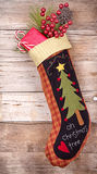 Christmas stocking with presents on wood Royalty Free Stock Photo
