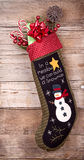 Christmas stocking with presents on wood Royalty Free Stock Image