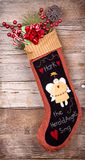 Christmas stocking with presents on wood Stock Photos