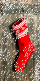 Christmas stocking. Red sock with snowflakes  and falling snow Royalty Free Stock Photo