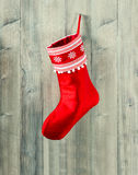 Christmas stocking. red sock with snowflakes for gifts Stock Photos