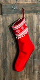Christmas stocking. Red sock with snowflakes for Santa gifts Stock Photo