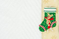 Christmas stocking with a reindeer with a gold ribbon on white c stock photography