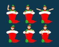 Christmas stocking and Santa Elf set. Little Claus helper. tradi Stock Photos