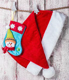 Christmas stocking and Santa hat Stock Images
