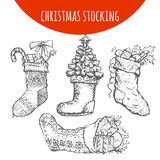Christmas stocking sock decoration with gifts vector sketch Stock Photos