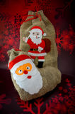 Christmas stocking. Two funny Christmas stocking on red background Stock Photo