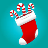 Christmas stocking. A vector illustration of a red Christmas stocking with candy canes sticking out of the top Royalty Free Stock Photography