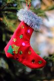 Christmas stockingis made with their own hands. Stocking on Christmas hanging on a Christmas tree stock image