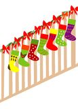 Christmas stockings. Few colorful Christmas stockings with ribbons Royalty Free Stock Image