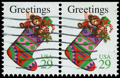 Christmas Stockings. USA-Circa 1908s: Cancelled postage stamps showing colorful Christmas stockings, circa 1980s Royalty Free Stock Photos