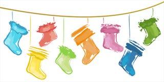 Christmas stockings. Sketchy colour Christmas stockings on strings Royalty Free Stock Photo
