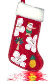 Christmas Stockings. Against a leather background. Santa Claus in hawaiian costume Royalty Free Stock Photo
